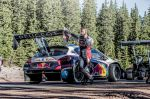 SebastienLoeb communicates with the engineers of Peugeot while waiting  to get down again after one session of test to Pikes peak with the Peugeot 208 T16 pikes peak