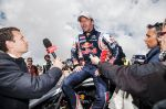 Sebastien Loeb speaks to the media after his victory at the Pikes Peak international hill climb race with the Peugeot 208 T16 pikes peak